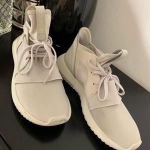 Creme adidas tubular shoes